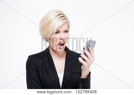 Disappointed businesswoman using smartphone isolated on a white background
