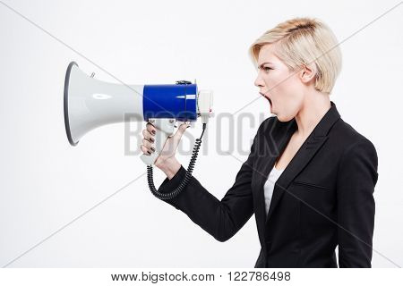 Businesswoman screaming into megaphone isolated on a white background