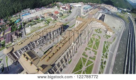 SOCHI, RUSSIA - AUG 1, 2014: Gorky Gorod Apart Hotels is located in the Caucasus mountains in Krasnaya Polyana, landscape with a birds eye view