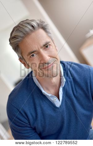 Portrait of smiling handsome man with grey hair