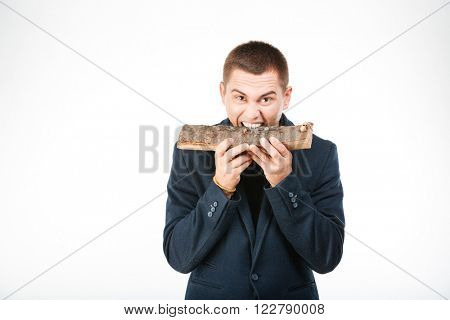 Businessman biting wooden timber isolated on a white background