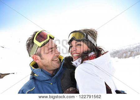Portrait of middle-aged couple at ski resort