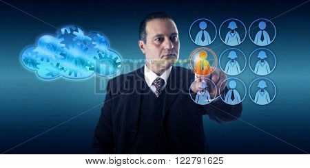 Business man selecting a worker by touch to move a work process into the cloud. Information technology concept for hybrid cloud deployment and transitioning infrastructure into a virtual ecosystem.