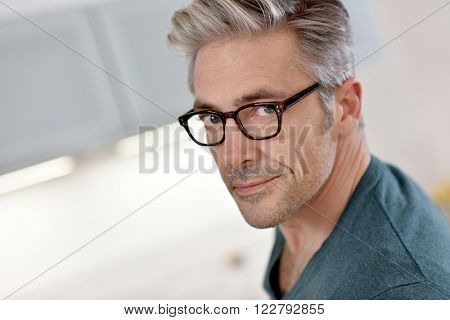 Portrait of handsome mature man with eyeglasses