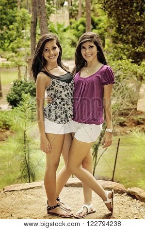 two young women posing in a beautiful park of Houston in a summer day