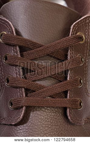close up of lace brown leather new shoes