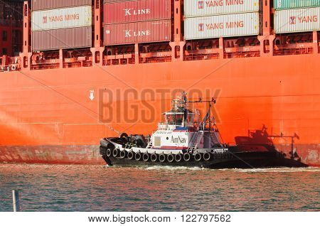 Alameda, CA - March 9, 2015: Oakland Oakland Container Shipyard, San Francisco Bay, the AmNAv tug