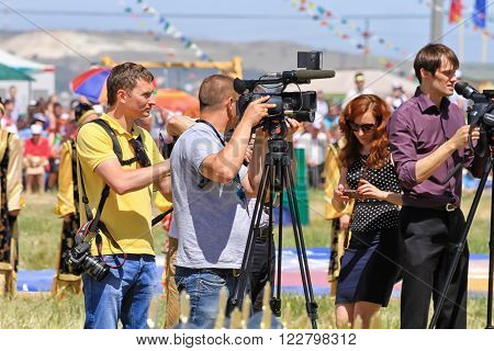 SMALL CHAPURNIKI, VOLGOGRAD, RUSSIA - MAY 24: Journalists with cameras and video cameras at the all-Russian rural Sabantuy. May 24, 2014 in Volgograd, Russia.