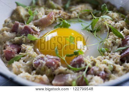 Coddled duck egg with Cornish crab, bacon & leeks