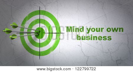 Business concept: target and Mind Your own Business on wall background
