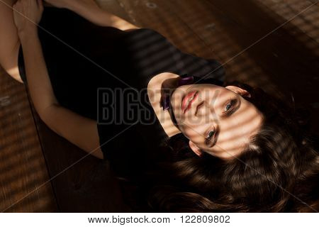 girl model with shadow from the blinds