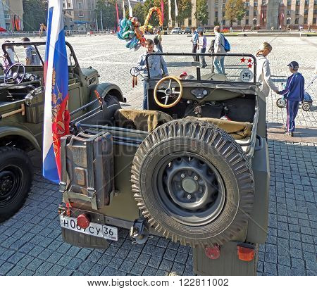 VORONEZH, RUSSIA - September 19, 2015: Passenger saloon of the soviet military all-wheel-drive vehicle light truck of World War II GAZ-67 without top up and with retro fuel can spare wheel on the city central square at the vintage car parade.