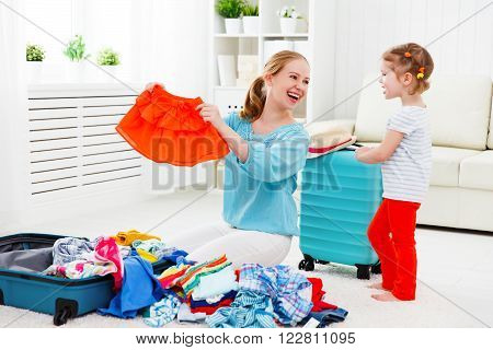 happy family tourist mother and child daughter suitcases packed for vacation