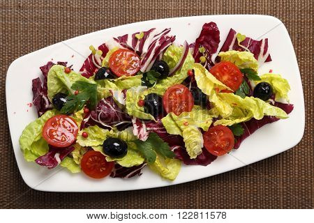 Salad with radicchio lettuce tomatoes and black olives