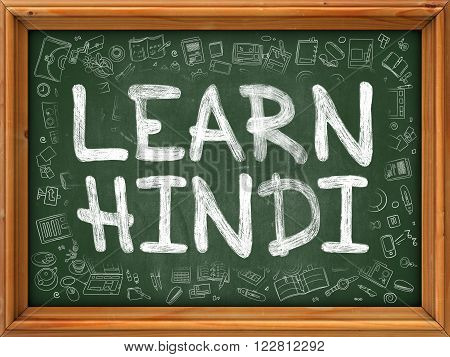 Green Chalkboard with Hand Drawn Learn Hindi with Doodle Icons Around. Line Style Illustration.