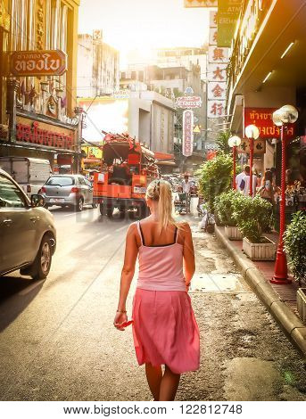 BANGKOK, Thailand - July 31: The China Town at Yaowarat Road. Young woman walking down the street, Thailand on July  31, 2010. ** Note: Soft Focus at 100%, best at smaller sizes ** Note: Visible grain at 100%, best at smaller sizes