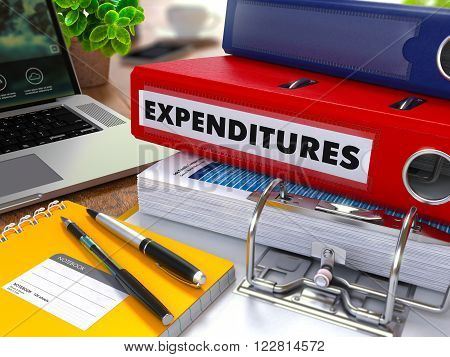 Red Ring Binder with Inscription Expenditures on Background of Working Table with Office Supplies, Laptop, Reports. Toned Illustration. Business Concept on Blurred Background. 3D Render.