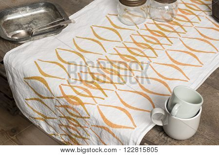 White Towel With Concave Line Design Between Tray And Cups