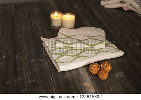Folded Towel And Napkin With Green Concave Line Design