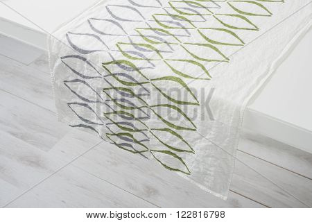 Towel With Purple And Green Concave Lines On White Counter