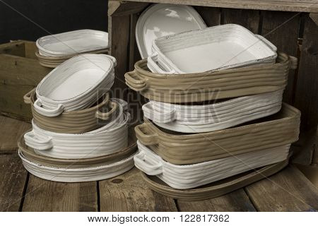 Two Stacks Of White And Tan-colored Earthenware