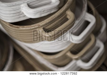 Close Up Of Stack Of White And Tan-colored Baking Dishes
