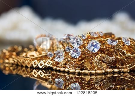 jewelry, gold, precious stones on black background