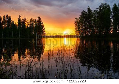 Beautiful sunset over a  Finnish lake in summer