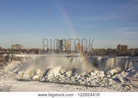 Rainbow Niagara Falls on the border Ontario river between the USA and Canada Ontario in winter time