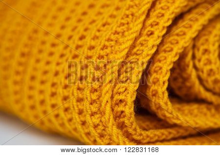 fabric orange knitted texture background with scarf clothing. ** Note: Shallow depth of field