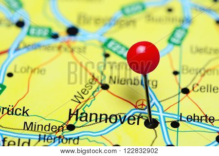 Photo of pinned Hannover a map of Germany. May be used as illustration for traveling theme.