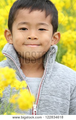 Japanese boy (6 years old) and yellow field mustard
