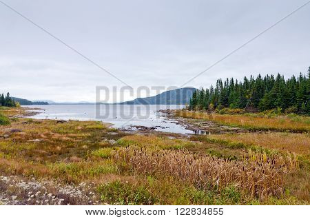 Lake in Jacques Cartier National Park under clouds sky