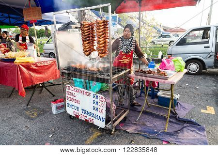 KUALA LUMPUR, May 30, 2015: Vendors selling cuisine at street bazaar catered for iftar or breaking fast during the Muslim fasting month of Ramadan. Fasting for the year of 2016 is scheduled to fall on June 6.