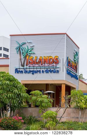 LONG BEACH CA/USA - MARCH 19 2016: Islands Fine Burgers & Drinks exterior and logo. Islands is a casual dining restaurant chain that specializes in hamburgers.