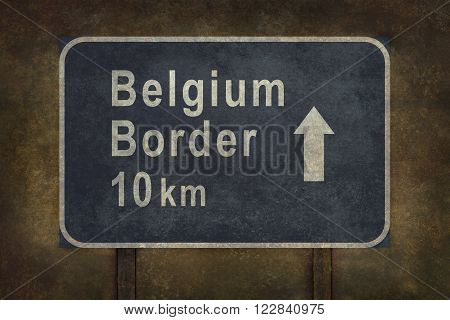 Belgium border 10 km directional roadside sign illustration with ominous background
