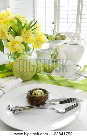 Assortment of colorful eggs with place setting for easter