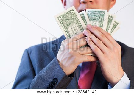 Greedy Business man showing off his money