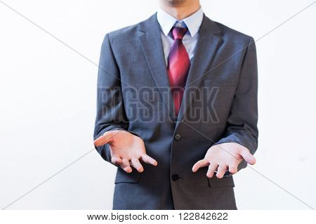 Business Man In Suit Showing Confused Sign On Isolated White Background