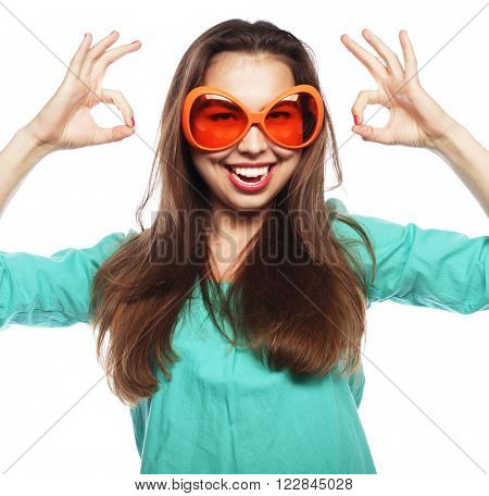 Party image. Playful young woman with  party glasses. Ready for good time.