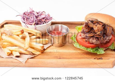 handmade hamburger with mushrooms and homemade french fries and cole slaw