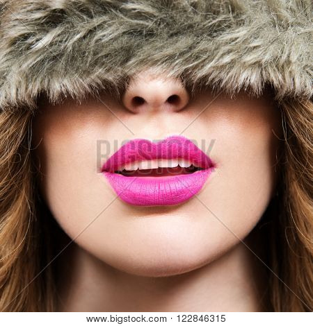 pink lips and black and white portrait of woman wearing winter hat