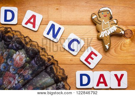 Gingerbread man in the form of a dancer on a wooden table