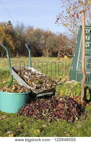 Compost bin, waste, mulch in a autumn garden.