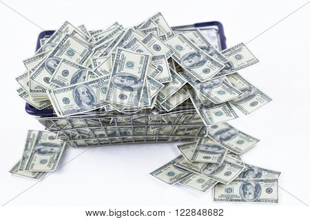 pile of money in shopping cart. Business and finance concept