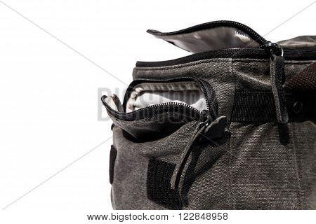 Close up opened camera bag, isolated on white background