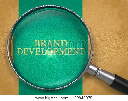 Brand Development through Lens on Old Paper with Blue Vertical Line Background. 3D Render.