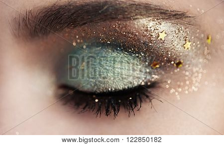Beautiful woman eye. Perfect makeup. Beauty fashion. Eyelashes. Lips. Cosmetic Eyeshadow. Make-up detail. Eyeliner.
