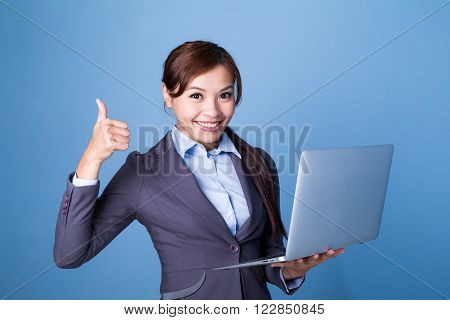 Businesswoman hold with laptop computer and thumb up