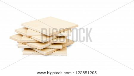Pile of tiles isolated on white background, close up view
